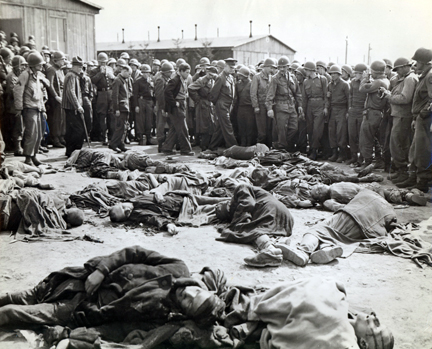 April 12, 1945 - DDE walks around a cluster of bodies of prisoners who were left lying where slain at Ohrdruf