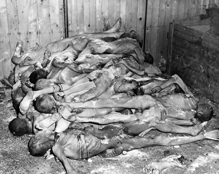 April 12, 1945 - Bodies of prisoners of Ohrdruf stacked like cord-wood
