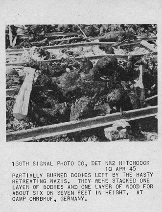 April 10, 1945 - Partially burned bodies left by retreating Nazis at Ohrdruf concentration camp. The bodies were stacked one layer of bodies and one layer of wood for about six or seven feet in height.