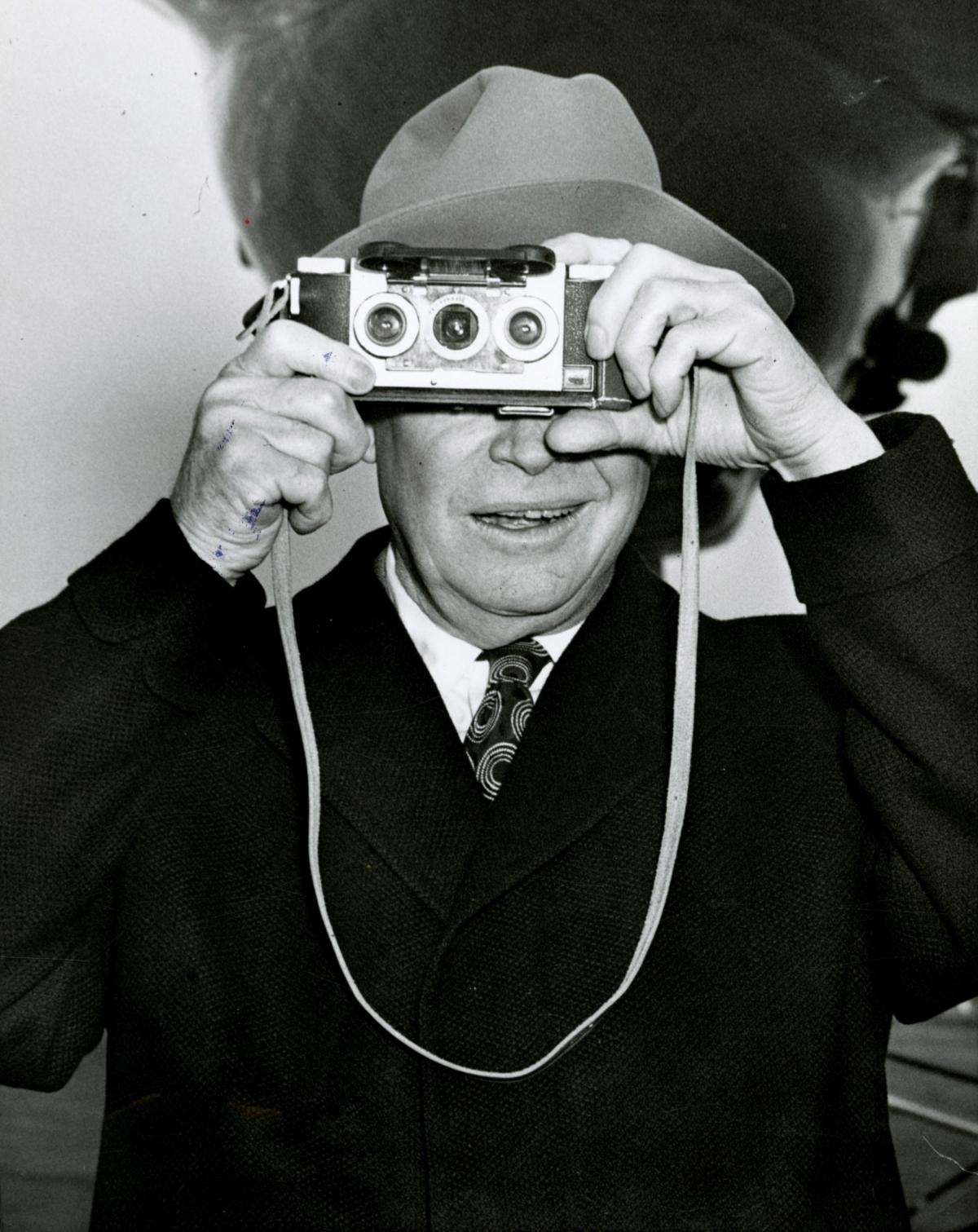 President Eisenhower photographs his photographers, Washington, D.C., December 25, 1953. [72-622-2]