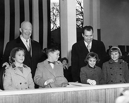 January 21, 1957 - Dwight D. Eisenhower on the reviewing stand with his grandchildren, Anne and David Eisenhower; and with Richard Nixon and his daughters, Julie and Tricia Nixon