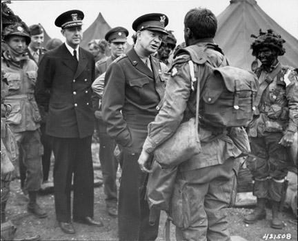 June 5, 1944 - DDE speaks with paratroopers of the 101st Airborne Division just before they board their planes to participate in the first assault of the Normandy invasion
