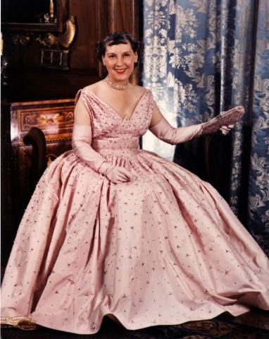 Mamie poses in her pink inaugural gown for a portrait by photographer Frank Turgeon.