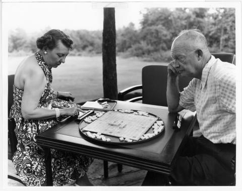Mamie and Ike play a board game at Camp David.