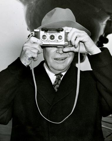 President Eisenhower photographs his photographers, Washington, D.C., December 25, 1953.