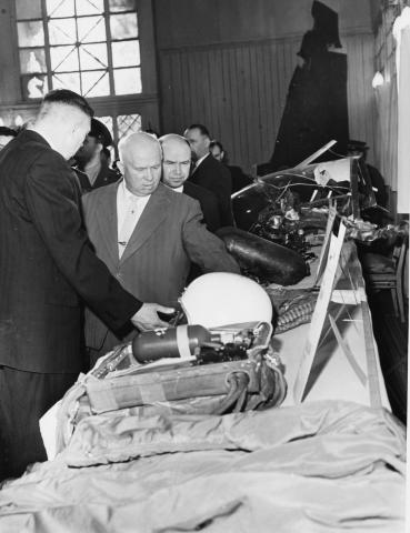 Soviet Premier Nikita Khrushchev and others examine display of U-2 wreckage. [79-5-11]