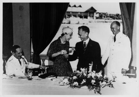 Luncheon given in honor of Dwight Eisenhower by Philippine President Manuel Quezon. L to R: General Douglas MacArthur, Mamie Eisenhower, Manuel Quezon, and Dwight D. Eisenhower, Manila, Philippines. 1939 [64-484]