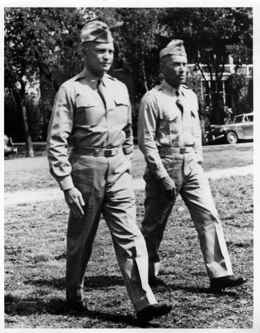 Dwight Eisenhower and unidentified officer walk across lawn at Fort Sam Houston in San Antonio, Texas, 1941 [64-58-1]