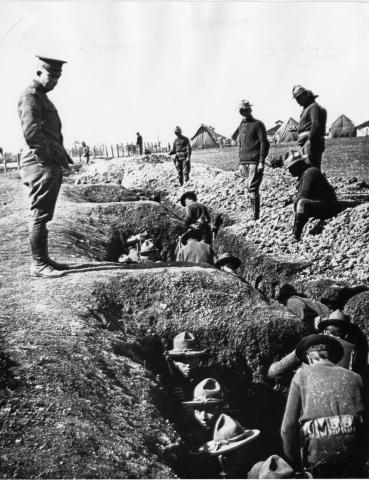 Dwight D. Eisenhower inspecting trenches dug by units of the Illinois National Guard while on Mexican border duty in 1916, at Fort Sam Houston, Texas. [65-859-1]