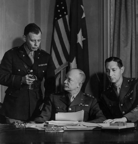 General Eisenhower, Major General Mark Clark, and General Walter Bedell Smith during a conference in London. September 29, 1942 [71-324]