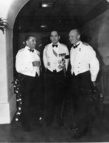 General Douglas MacArthur, Major Dwight D. Eisenhower, and Captain T.J. Davis are shown in formal dress at Malacanang Palace in Manila, The Philippines, 1935 [71-368-1]