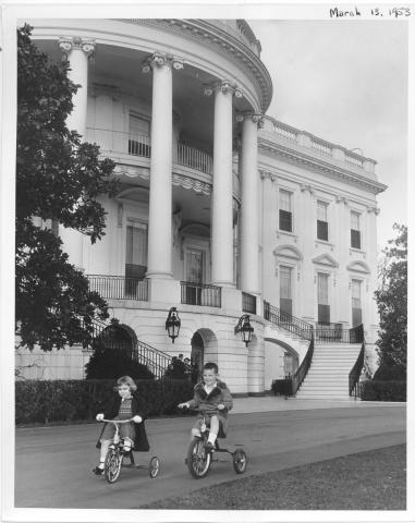 Grandchildren of Dwight D. Eisenhower  visit the White House.  They play on the steps and ride their tricycles on the grounds.   Dwight David Eisenhower II, Barbara Ann Eisenhower, and Susan Eisenhower. March 13, 1953 [72-119-2]