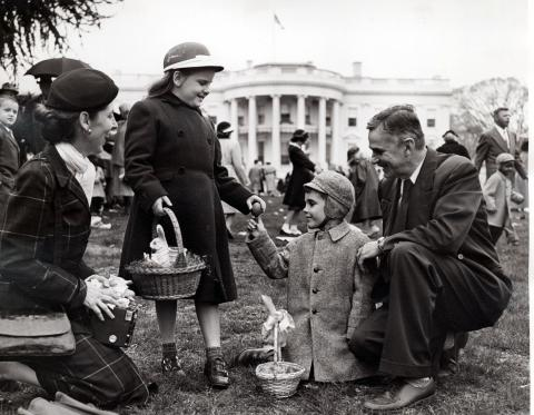 Unidentified family at Easter Egg Rolling festivities on the south lawn of the White House. April 6, 1953 [72-190-16]