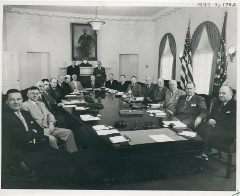 Dwight D. Eisenhower, members of the Cabinet, and Administrative Assistants are pictured in the Cabinet Room of the White House. May 8, 1953 [72-262-3]