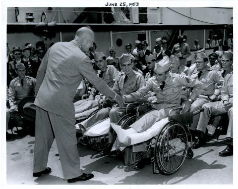 Dwight D. Eisenhower greets the hospitalized veterans on the Presidential Yacht, USS Williamsburg June 25, 1953 [72-351-3]