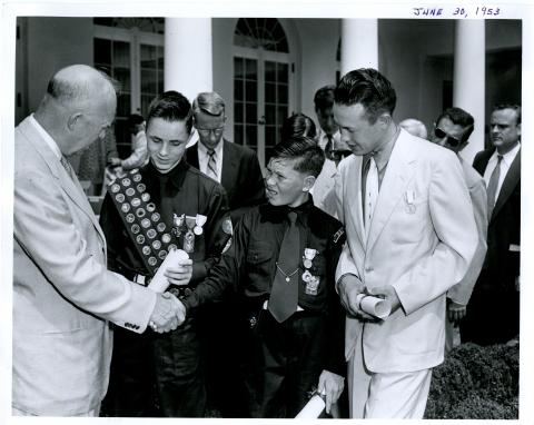 Dwight D. Eisenhower presents Young American Medals for Bravery and Service to three young boys in the White House Rose Garden. June 30, 1953 [72-362-2]