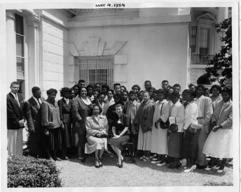 Mamie Eisenhower receives students of the Robert L. Vanna High School in Ahaskie, North Carolina. The meeting took place on the White House Lawn. May 4, 1954 [72-845]