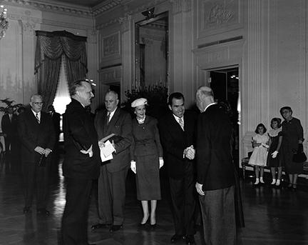 January 20, 1957 - Vice President Nixon shaking hands with Dwight D. Eisenhower during the private ceremony held in the East Room of the White House