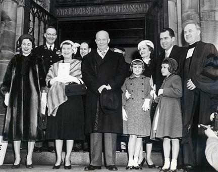 January 20, 1957 - Dwight D. Eisenhower and Richard Nixon leaving the National Presbyterian Church following a pre-inaugural service. The service took place before the private swearing in ceremony. Shown from L to R are: Barbara Eisenhower, John S.D. Eisenhower, Mamie Eisenhower, President Eisenhower, Tricia Nixon, Pat Nixon, Richard Nixon with Julie Nixon standing in front of him, and Reverend Edward Elson