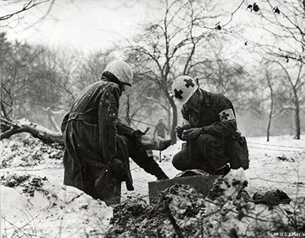 Ardennes-Battle of the Bulge. January 15, 1945 - First aid in the woods near Tittingen, Germany.