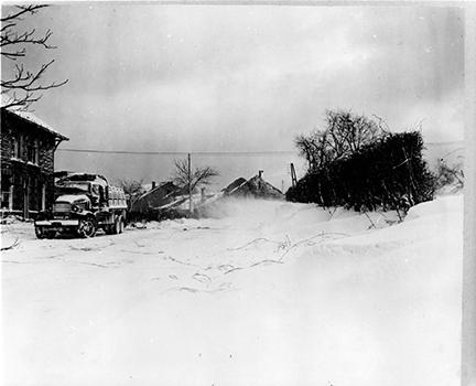 Ardennes-Battle of the Bulge. January 19, 1945 - The passing of a blizzard in Wanne, Belgium.