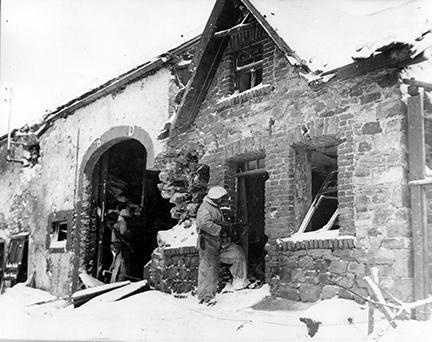 Ardennes-Battle of the Bulge. January 21, 1945 - A house to house search for snipers in Schoppen, Belgium, by men of the 1st Division.