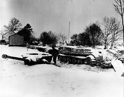 Ardennes-Battle of the Bulge. January 23, 1945 - A Mark VI Tiger tank was rendered useless by tanks of th 6th Armored Division in Moinet, Belgium.