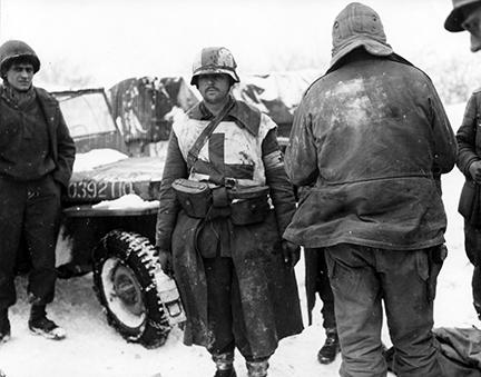 Ardennes-Battle of the Bulge. January 24, 1945 - A German medic carried his supplies in the two U.S. field glass cases hung on his belt when captured by the 1st Army at Butgenbach, Belgium. Snow covers the ground.