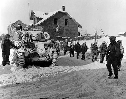 Ardennes-Battle of the Bulge. January 24, 1945 - Parachute infantry move on snow covered ground toward the front to keep up the pressure being applied to the Germans beyond St. Vith, Belgium.