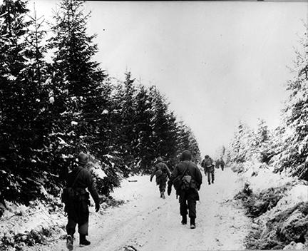 Ardennes-Battle of the Bulge. January 15, 1945 - Some of the 83rd Division moving toward the front in the Houffalize sector, Belgium.