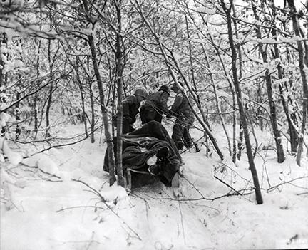 Ardennes-Battle of the Bulge. January 12, 1945 - Medics remove an American casualty from the wood near Berle, Luxembourg.