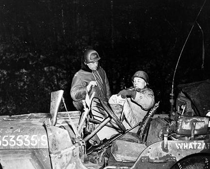Ardennes-Battle of the Bulge. January 1, 1945 - Major General Maurice Rose (left) confers with Brigadier General Doyle O. Hickey as the column of armor which they are leading is temporarily held up by enemy artillery fire on the outskirts of Floret, Belgium.