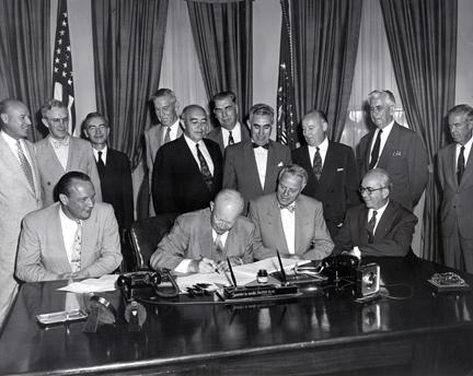 "Augus 30, 1954 -Dwight D. Eisenhower signs H.R. 9757, an act ""to amend the Atomic Energy Act of 1946."" The signing was witnessed in his office by various senators, congressmen and members of the Atomic Energy Commission."