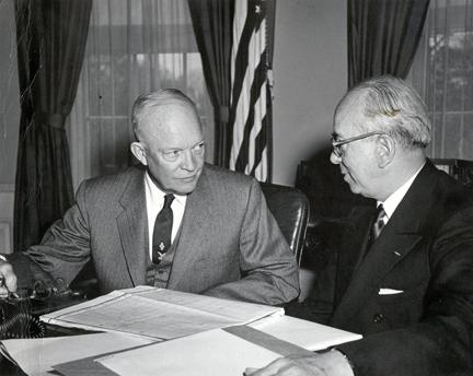 March 30,1954 - Dwight D. Eisenhower receives a report from Lewis L. Strauss, Chairman of the Atomic Energy Commission, on the hydrogen bomb tests in the Pacific.