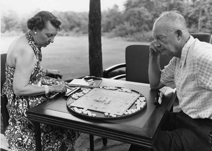 July 30/31, 1954 - Dwight and Mamie Eisenhower relax with a game while vacationing at Camp David