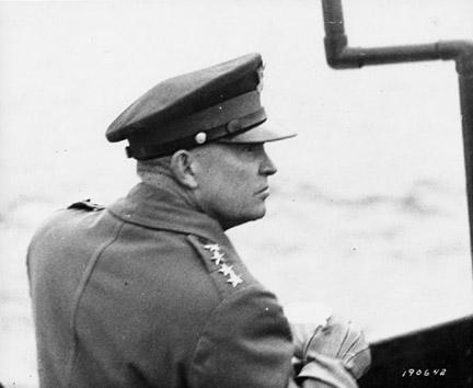 June 7, 1944 - Dwight D. Eisenhower observes air activity from the deck of a warship in the English Channel off the French coast