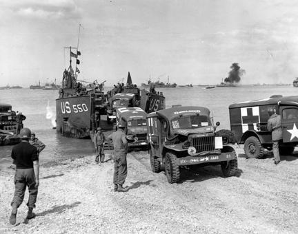 July 1, 1944 - This Rhino ferry unloads its cargo of Army ambulances on a beach in France, to provide equipment for more front line hospitals