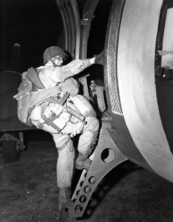 June 6, 1944 - A paratrooper loads for take off in England in preparation to leave for invasion