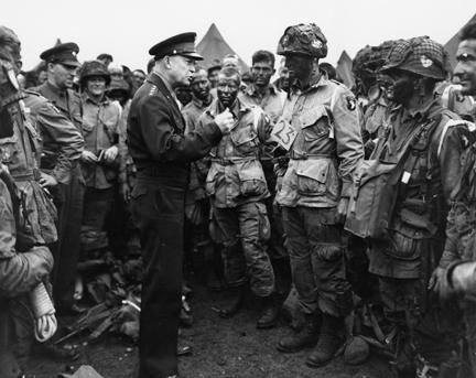 June 5, 1944 - Dwight D. Eisenhower speaks with paratroopers of the 101st Airborne Division just before they board their planes to participate in the first assault of the Normandy invasion [77-18-112]
