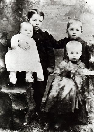 1893 - This is the first known photograph of DDE. Arthur is holding Roy and DDE is sitting in front of Edgar.