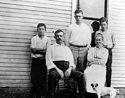 1910 - DDE with his parents and two brothers. L to R: Milton, David, DDE, Ida, and Earl (and dog Flip)