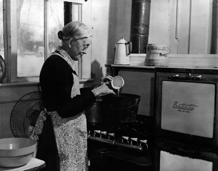 Ida Eisenhower cooking in her kitchen in the Eisenhower home