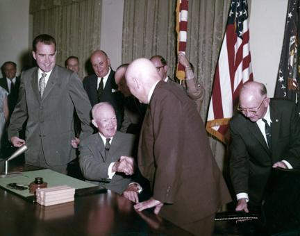 August 21, 1959 - Admitting Hawaii as the 50th state to join the Union. Dwight D. Eisenhower with Fred Seaton, Daniel K. Inouye, Edward Johnson, Sam Rayburn, Richard Nixon, Lt. Col. James S. Cook, Jr., and Maj. Gen. A.T. McNamara. [77-18-1154]