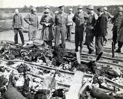 April 12, 1945 - Dwight D. Eisenhower views the charred bodies of prisoners at Ohrdruf