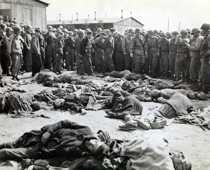April 12, 1945 - Dwight D. Eisenhower walks around a cluster of bodies of prisoners who were left lying where slain at Ohrdruf