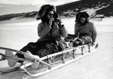 Antarctica - Chilean geologist Fernando Hunizaga and Texas Technological College geologist Charles King on a sled in the Shackleton Glacier Area. They are members of a party making a study of the terrain in the area of the Roberts Massif.