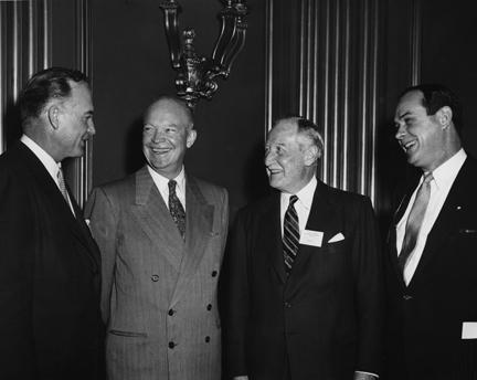 February 17, 1954 - White House Conference on Traffic Safety. Left to Right: Gov. Dan Thornton of Colorado, chairman of the conference steering committee; Dwight D. Eisenhower; M. H. Curtice, president of General Motors and chairman of the business committee; and Rear Adm. Harold B. Miller (ret.), conference director.