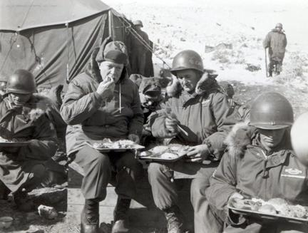 "December 4, 1952 - Dwight D. Eisenhower and Sgt. Virgil Hutcherson, Squad Leader, Co. ""B"", 15th Infantry Regiment, 3rd US Infantry Division, eat dinner in Korea [77-18-898]"