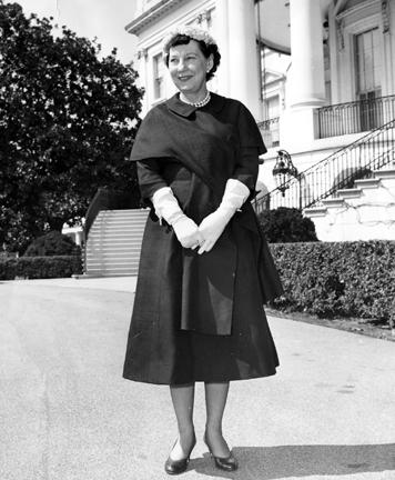 March 22, 1956. Mamie Eisenhower standing outside the White House.