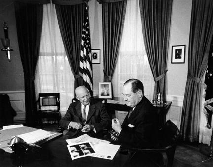 April 1, 1960 - Dwight D. Eisenhower and Dr. T. Keith Glennan review photographs transmitted from Satellite Tiros I. The satellite was designed under NASA's national program in space exploration to aid in meterorological research.